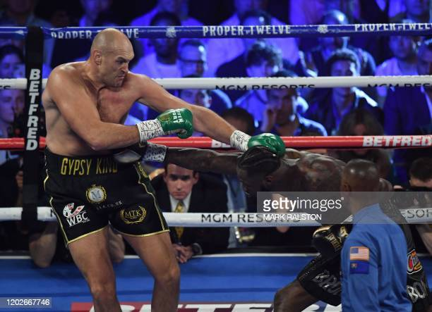 British boxer Tyson Fury lands a punch on US boxer Deontay Wilder during their World Boxing Council Heavyweight Championship Title boxing match at...