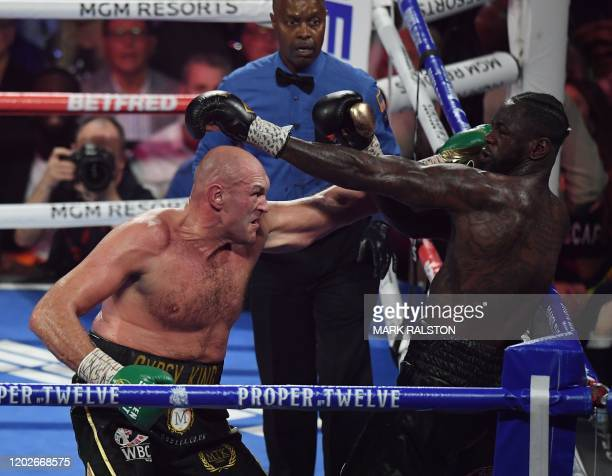 British boxer Tyson Fury lands a punch on US boxer Deontay Wilder before defeating him in the seventh round during their World Boxing Council...