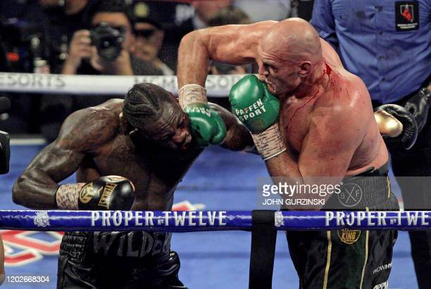 British boxer Tyson Fury slams a right to the head of US boxer Deontay Wilder during their World Boxing Council Heavyweight Championship Title boxing...