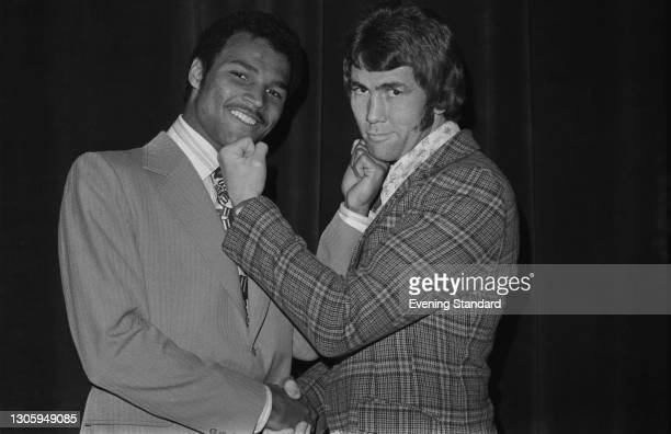 British boxers John Conteh and Chris Finnegan during the weigh-in for their British and Commonwealth light heavyweight title fight at the Empire Pool...