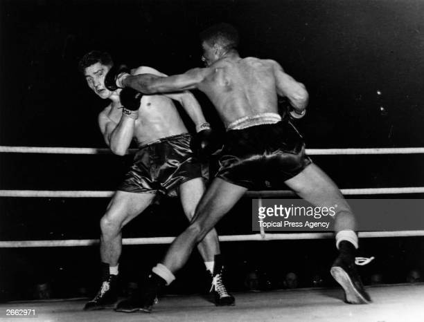 British boxers Randolph Turpin of Leamington and Don Cockell of Battersea in action during their British and Empire light heavyweight title fight at...