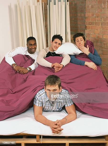 British boy band Blue sharing a duvet London circa 2003 They are Simon Webbe Lee Ryan Duncan James and Antony Costa