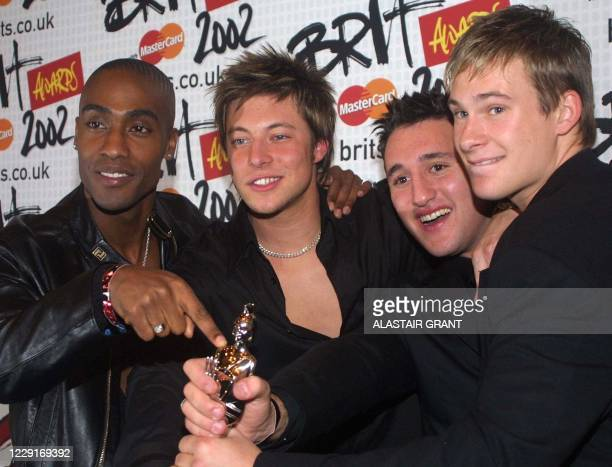 British boy band 'Blue' Simon Webb, Duncan James, Antony Costa and Lee Ryan, pose for the media with the Best Newcomer award of the 2002 Brit Awards,...