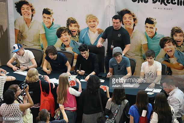 British boy band One Direction members Harry Styles Niall Horan Zayn Malik Liam Payne and Louis Tomlinson greet fans and sign autographs at Mall of...