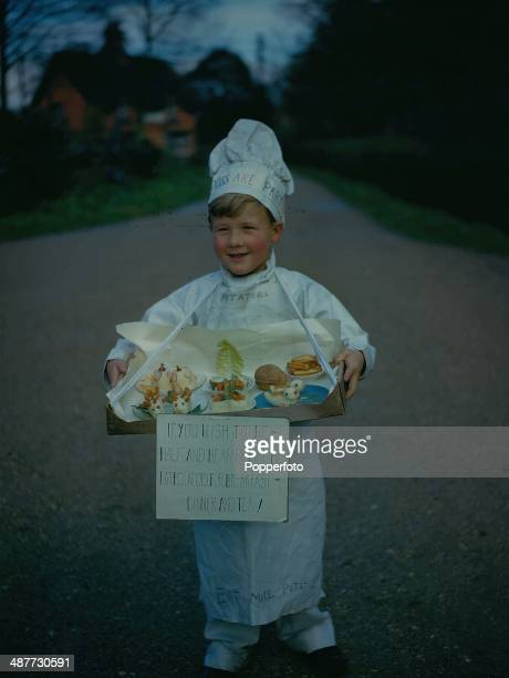 1943 British boy David Green wearing a chef costume rehearsing for a play preaching the doctrine of food saving during World War Two in the village...