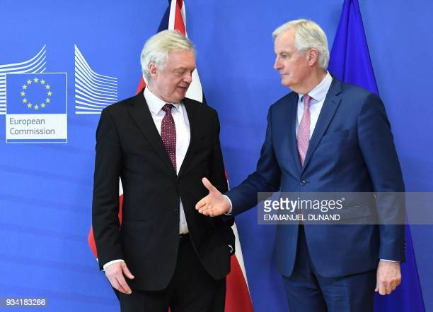 British Brexit minister David Davis and EU chief negotiator Michel Barnier meet at the European Commission in Brussels on March 19 2018 / AFP PHOTO /...