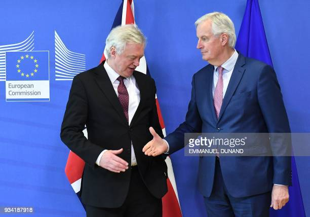 British Brexit minister David Davis and EU chief negotiator Michel Barnier prepare to shake hands as they meet at the European Commission in Brussels...