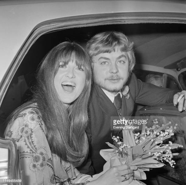 British broadcaster and journalist Cathy McGowan and Welsh actor Hywel Bennett sit in the back of a car on their wedding day UK 17th January 1970