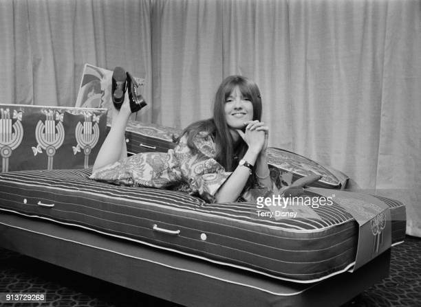 British broadcaster and journalist Cathy McGowan on a bed she has designed London UK 25th January 1968