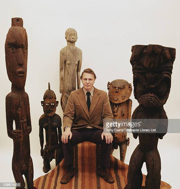British broadcaster and naturalist Sir David Attenborough, sitting on a chair, 1975.