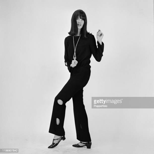 British broadcaster Cathy McGowan presenter of the music televsion programme Ready Steady Go pictured wearing black trousers and blouse in London in...