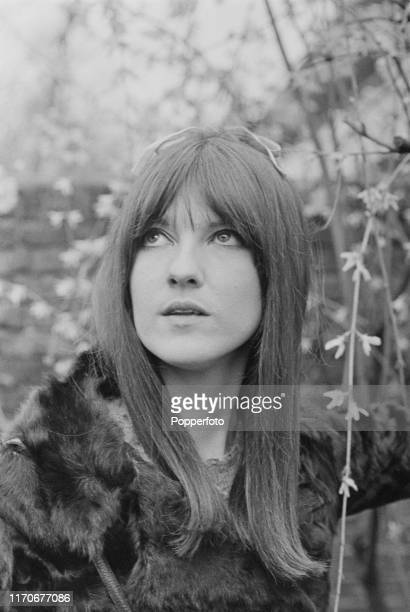 British broadcaster Cathy McGowan presenter of the music televsion programme Ready Steady Go in a garden at home in April 1966