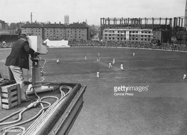 British Broadcasting Corporation television camera follows play at the wicket as Leonard Hutton and Maurice Leyland of England bat in the 1st innings...
