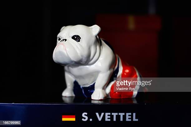 British Bulldog figurine sits on the car of Sebastian Vettel of Germany and Infiniti Red Bull Racing during previews to the Chinese Formula One Grand...