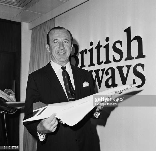 British business executive David Nicolson , Chairman of British Airways, with a model of supersonic airliner Concorde at a press conference, UK, 12th...