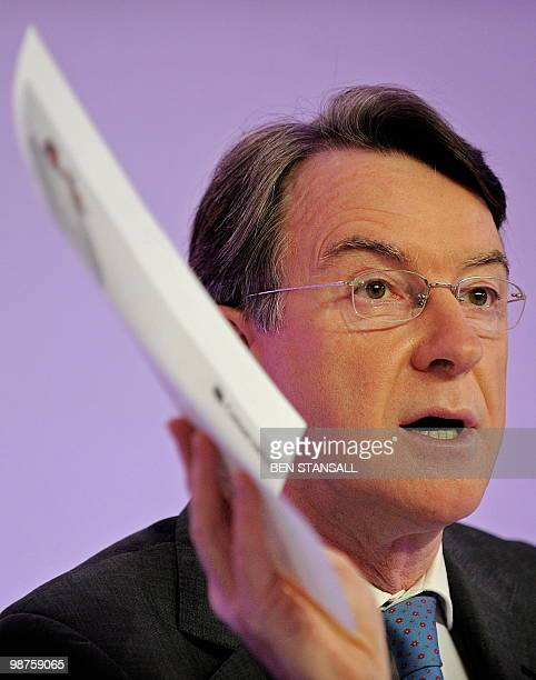 British Business Minister Peter Mandelson holds a copy of the oppostion Conservative party's manifesto during a press conference with Prime Minister...