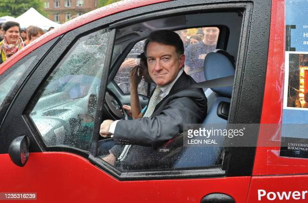 British Business Secretary Peter Mandelson is driven around the campus at the University of Birmingham, in Birmingham, central England on April 29,...