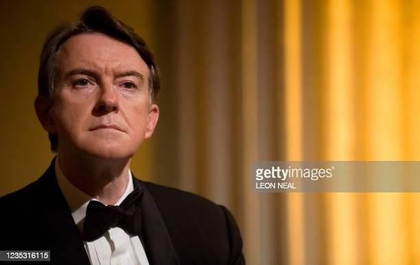 British Business Secretary Peter Mandelson listens as Brazilian President Luiz Inacio Lula da Silva is named as the winner of the Chatham House Prize...