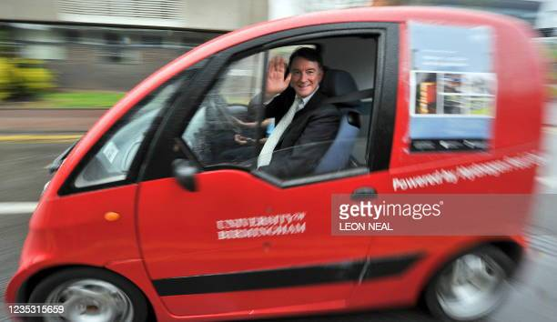 British Business Secretary Peter Mandelson waves as he is driven around the campus at the University of Birmingham, in Birmingham, central England on...