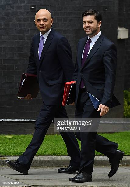 British Business Secretary Sajid Javid and British Work and Pensions Secretary Stephen Crabb arrive to attend a cabinet meeting at 10 Downing Street...
