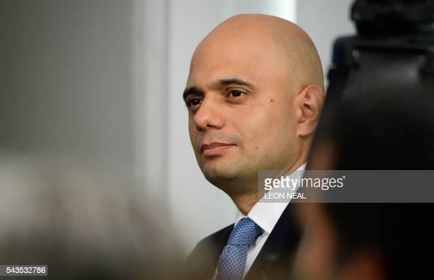 British Business Secretary Sajid Javid listens as British Work and Pensions Secretary and Conservative MP Stephen Crabb speaks during a news...