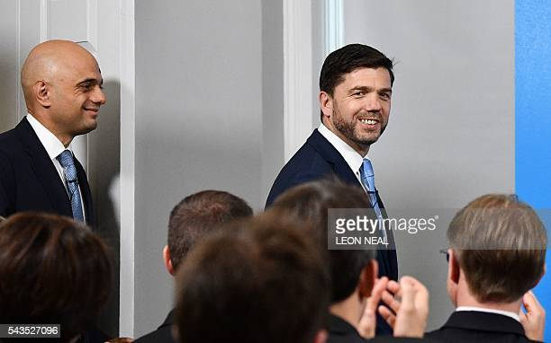 British Business Secretary Sajid Javid smiles as he arrives with British Work and Pensions Secretary and Conservative MP Stephen Crabb at a news...
