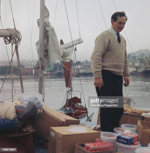 British businessman and amateur sailor Donald Crowhurst loading provisions of porridge oats and tea aboard his trimaran Teignmouth Electron prior to...