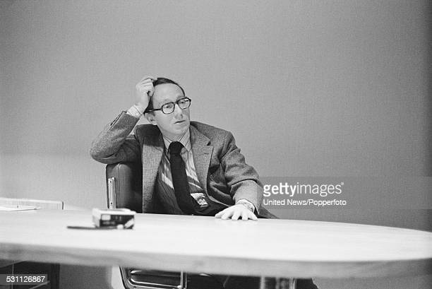 British businessman and deputy chairman of the supermarket chain Sainsbury's Simon Sainsbury pictured sitting at a desk in London on 16th December...