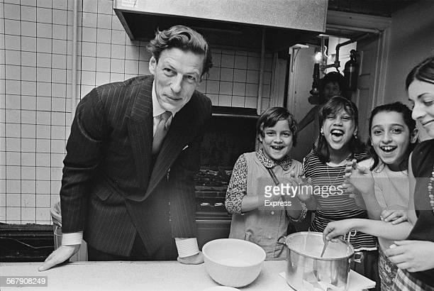 British businessman and husband of Princess Alexandra of Kent Angus Ogilvy visiting a school in Brooklyn during his tour of America with the Princess...