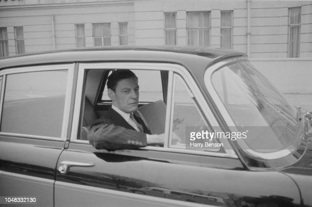 British businessman Angus Ogilvy pictured driving his Vanden Plas Princess car on the morning of his wedding to Princess Alexandra in London on 24th...