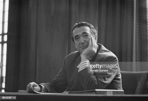 British businessman Robert Maxwell former owner of Pergamon Press pictured seated at a desk in London on 21st November 1973