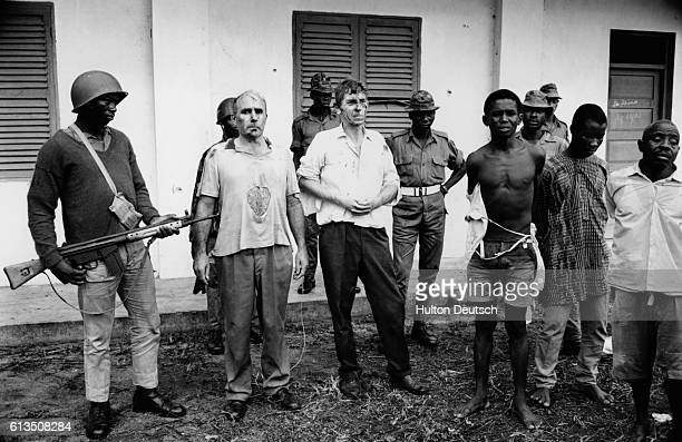 British businessmen John Downing a tractor company salesman and William Blakeley a marine manager are held prisoner after being captured and beaten...