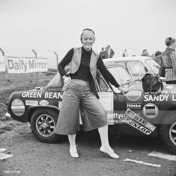 British businesswoman and racing driver Jean Denton posed with her and Sandy Lawson's AustinHealey Sprite Mark III car before the start of a stage of...