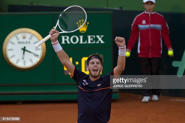 British Cameron Norrie celebrates after winning against Spain's Roberto Bautista during the first round of the Davis Cup tennis match between Spain...
