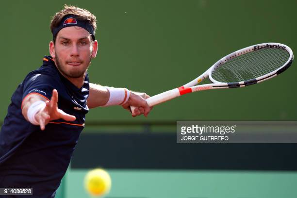 British Cameron Norrie returns the ball to Spain´s Spain's Albert Ramos during the first round of the Davis Cup tennis match between Spain and Great...