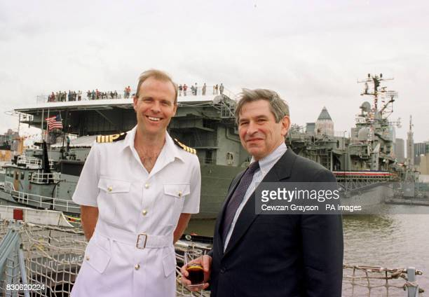 British Captain Duncan Potts commanding officer of the HMS Marlborough and Paul Wolfowitz US Deputy Secretary of Defense stand in front of the US...