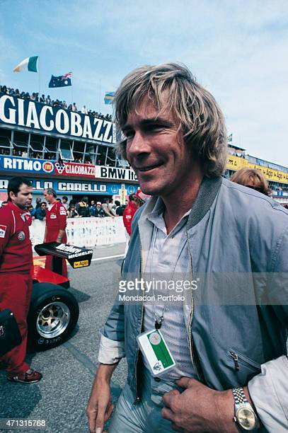 British car racing driver James Hunt smiling on a race-track. 1970s