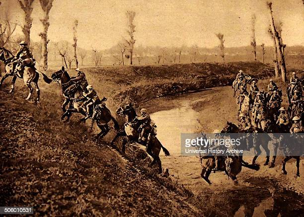 British cavalry charge across a river during World War One