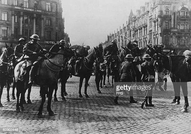 British cavalrymen dismount in the square at Dusseldorf during the Allied occupation of Germany after World War I circa 1920
