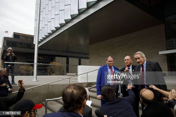 British cave expert Vernon Unsworth center stands with attorneys Mark Stephens left and L Lin Wood as they speak to members of the media outside...