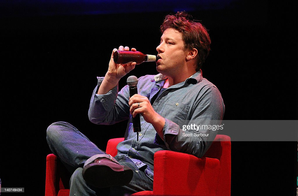 British Celebrity Chef Jamie Oliver drinks a beer as he speaks to an audience about responsible eating during an engagement at the Wheeler Centre on March 6, 2012 in Melbourne, Australia. The Government and the Good Foundation will pledge together over AUD5 million to bring Oliver's Ministry of Food to the state to help teach cooking techniques and nutrition to participants and help combat obesity as part of the Victorian Helathy Eating Enterprise.