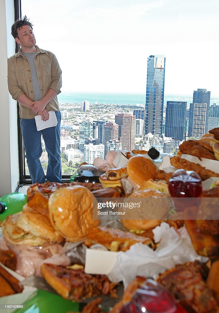 British Celebrity Chef Jamie Oliver stands in front of a table full of junk food as he prepares to announce a partnership to attack state-wide obesity on March 6, 2012 in Melbourne, Australia. The Victorian Government and the Good Foundation will pledge together over AUD5 million to bring Oliver's 'Ministry of Food' to the state to help teach cooking techniques and nutrition to participants and help combat obesity as part of the Victorian Healthy Eating Enterprise.