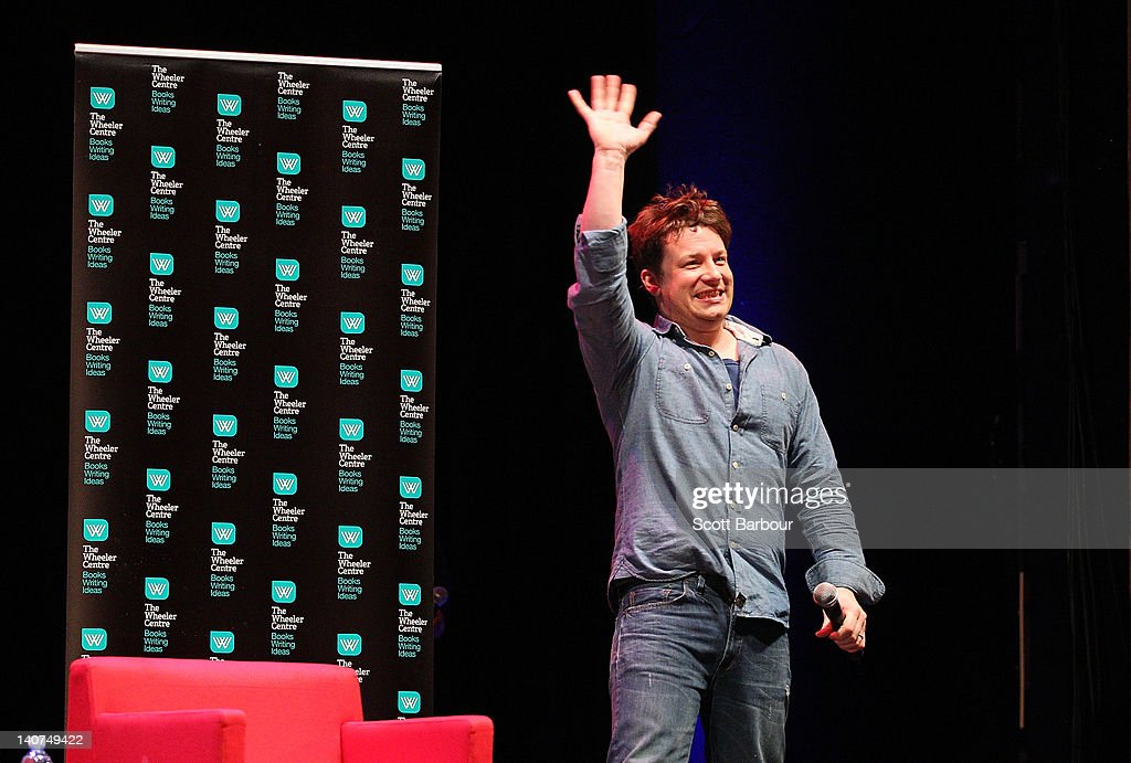 British Celebrity Chef Jamie Oliver waves as he arrives on stage to speak to an audience about responsible eating during an engagement at the Wheeler Centre on March 6, 2012 in Melbourne, Australia. The Government and the Good Foundation will pledge together over AUD5 million to bring Oliver's Ministry of Food to the state to help teach cooking techniques and nutrition to participants and help combat obesity as part of the Victorian Healthy Eating Enterprise.