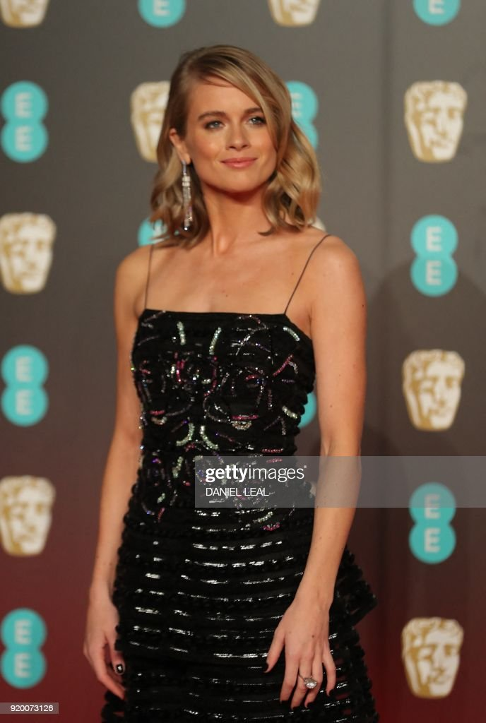 British celebrity Cressida Bonas poses on the red carpet upon arrival at the BAFTA British Academy Film Awards at the Royal Albert Hall in London on February 18, 2018. / AFP PHOTO / Daniel LEAL