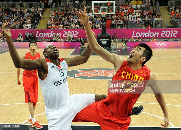 British centre Eric Boateng vies with Chinese centre Zhang Zhaoxu during the men's basketball preliminary round match Great Britain vs China as part...