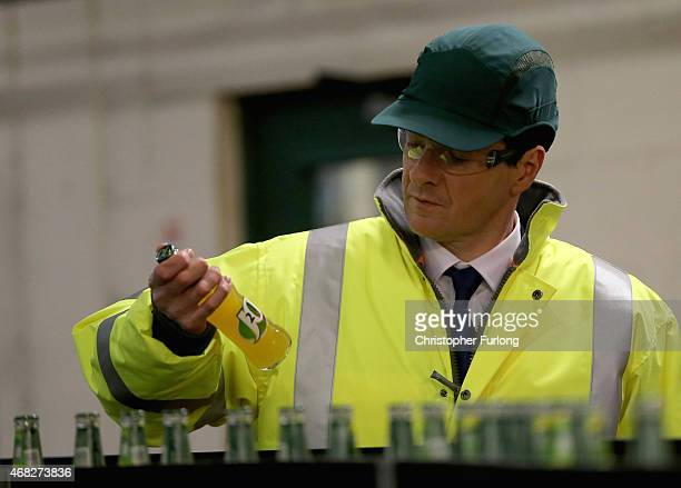 British Chancellor and Conservative MP George Osborne tours the production line during a visit to Britvic Soft Drinks Ltd on April 1 2015 in Leeds...