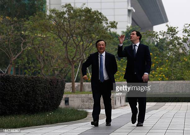 British Chancellor George Osborne and Huawei CEO and founder Ren Zhengfei walk through a campus at the Huawei headquarters in the southern Chinese...