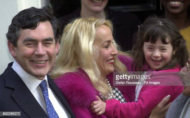 British Chancellor Gordon Brown meets Jerry Hall and Annalie Hertz outside11, Downing Street, to launch an appeal to persuade everyone to write their...