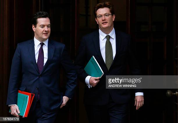 British Chancellor of the Exchequer George Osborne and Chief Secretary to the Treasury Danny Alexander leave the Treasury ahead of their presentation...