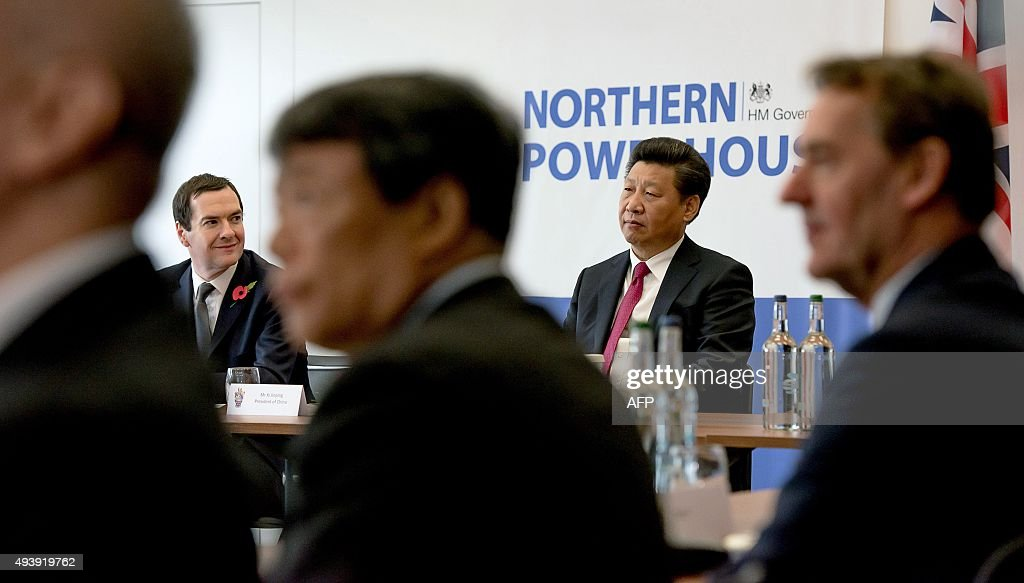 British Chancellor of the Exchequer George Osborne (L) and Chinese President Xi Jinping listen to a speech during his visit to Britain's National Graphene Institute at the University of Manchester in Manchester, north west England on October 23, 2015. Chinese President Xi Jinping blew the final whistle on his state visit to Britain today with a day out at the English Premier League leaders Manchester City.